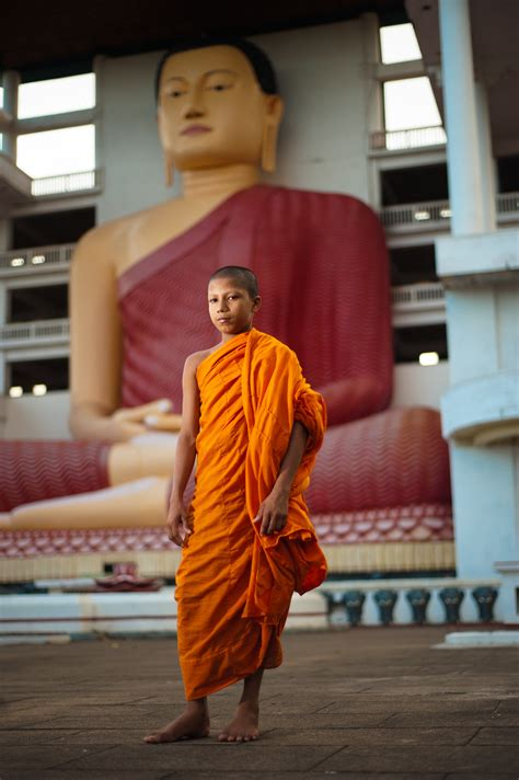 File:A young monk against the background of Big Buddha